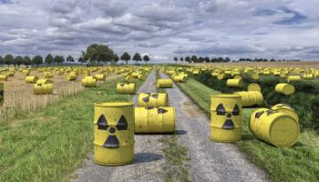 Photo illustration with waste barrels in field.