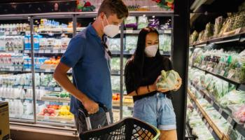 Couple shopping in produce section.